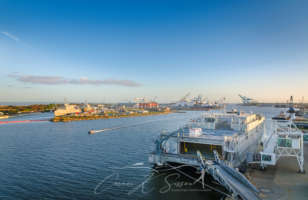 A pontoon boat passes between Pinto Island and the Alabama Cruise Terminal, November 27, 2015, in Mobile, Alabama. The Port of Mobile was ranked the 12th largest deepwater port by tonnage in the nation in 2010, dropping from its 2008 ranking of ninth. The port is located along the Mobile River, which empties into Mobile Bay. Its depth is 45 feet. Carnival Cruise Lines operated out of the Alabama Cruise Terminal from 2004-2011, then took a five-year hiatus before returning to the area in November 2016. (Photo by Carmen K. Sisson/Cloudybright)