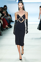 Pauline Hoarau walks the runway wearing Cushnie et Ochs Fall 2016, hair by Antonio Corral Calero for Moroccanoil, makeup by Val Garland, photographed by Thomas Concordia during New York Fashion Week on February 12, 2016