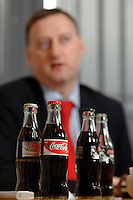 24 JAN 2007, BERLIN/GERMANY:<br /> Coca-Cola Flaschen auf dem tisch, waehrend einem Interview mit Daimian Gammell, Vorstandsvorsitzender Coca-Cola Erfrischungsgetraenke GmbH<br /> IMAGE: 20070124-01-025<br /> KEYWORDS: Coca-Cola Erfrischungsgetränke