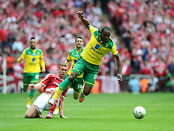 Norwich City's Cameron Jerome battles for the ball with Middlesbrough's Ben Gibson  - Photo mandatory by-line: Joe Meredith/JMP - Mobile: 07966 386802 - 25/05/2015 - SPORT - Football - London - Wembley Stadium - Middlesbrough v Norwich - Sky Bet Championship - Play-Off Final