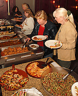 Weigie Pomianowski of Beavercreek (right) as Riverside Area Chamber of Commerce hosts an International Night featuring Indian and American food at the Filling Station Sports Bar & Grill in Riverside, Monday, March 26, 2012.  Owner Doctor Suresh Gupta prepared Indian cuisine including Bean Sprout Cucumber Salad, Butter Chicken, Samosas, Rice/Naan Bread and Veggie Khorma.