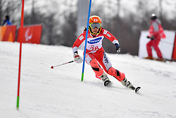 HONDO Ammi LW6/8-2 JPN competing in the ParaSkiAlpin, Para Alpine Skiing, Slalom at the PyeongChang2018 Winter Paralympic Games, South Korea.