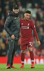 LIVERPOOL, ENGLAND - Friday, April 26, 2019: Liverpool's manager Jürgen Klopp (L) and Alex Oxlade-Chamberlain (L) celebrate after the FA Premier League match between Liverpool FC and Huddersfield Town AFC at Anfield. Liverpool won 5-0. (Pic by David Rawcliffe/Propaganda)
