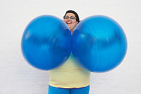 Happy Overweight Woman Holding Exercise Balls