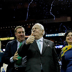 April 15, 2012; New Orleans, LA, USA; New Orleans Hornets newly named owner Tom Benson along with his wife Gayle and New Orleans Saints, Executive Vice President/Chief Financial Officer Dennis Lauscha and his wife Jennifer celebrate as confetti falls behind them following a 88-75 win over the Memphis Grizzlies at the New Orleans Arena.   Mandatory Credit: Derick E. Hingle-US PRESSWIRE