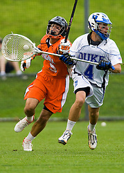 Virginia attackman Danny Glading (9) tries to knock the ball away from Duke Goalie Dan Loftus (4).  The #2 ranked Duke Blue Devils defeated the #3 ranked Virginia Cavaliers 11-9 in the finals of the Men's 2008 Atlantic Coast Conference tournament at the University of Virginia's Klockner Stadium in Charlottesville, VA on April 27, 2008.