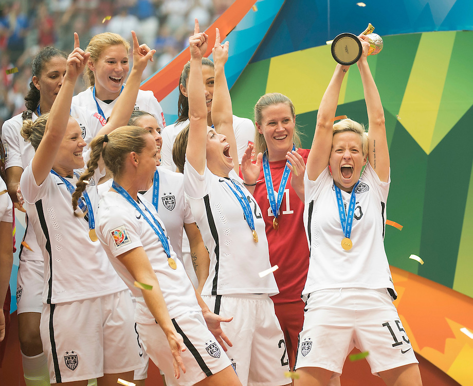 Megan Rapinoe of team USA hoists high the FIFA 2015 World Cup trophy while celebrating with team USA's victory over Japan during 2015 women's World Cup Soccer in Vancouver during the final between USA and Japan.