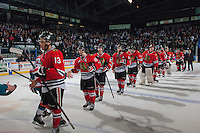 KELOWNA, CANADA - APRIL 25: The Portland Winterhawks shake hands with the # of the Kelowna Rockets on April 25, 2014 during Game 5 of the third round of WHL Playoffs at Prospera Place in Kelowna, British Columbia, Canada. The Portland Winterhawks won 7 - 3 and took the Western Conference Championship for the fourth year in a row earning them a place in the WHL final.  (Photo by Marissa Baecker/Getty Images)  *** Local Caption ***