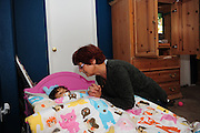 SUN-STAR PHOTO BY BEA AHBECK<br /> 8:10 p.m. Renate says a prayer with granddaughter Dessira, 2, as she puts her to bed in their Atwater home on Nov. 15, 2010.