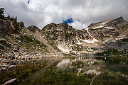 Amphitheatre Lake, Grand Teton National Park, Wyoming, USA. After a climb of 910m from Lupine Meadows, hikers arrive at the incredible Amphitheatre lake, at an altitude of 2956m, sitting in a granite bowl in the Rocky Mountains.