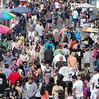 Hundreds of people walk on the Santa Monica Pier on Saturday, April 23, 2011.