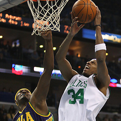 Feb 10, 2010; New Orleans, LA, USA; Boston Celtics forward Paul Pierce (34) shoots over New Orleans Hornets forward James Posey (41) during the first half at the New Orleans Arena. Mandatory Credit: Derick E. Hingle-US PRESSWIRE