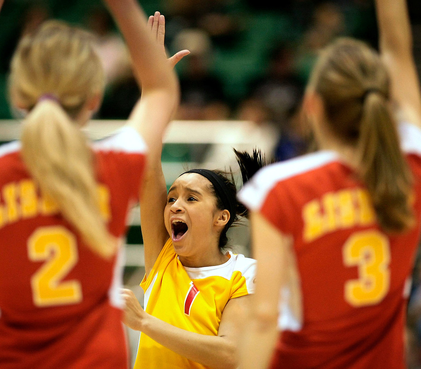Lisbon's Ashley Berg reacts with teammates after scoring against Langdon during the first round of the 2008 North Dakota Class B tournament at the Minot State Dome.