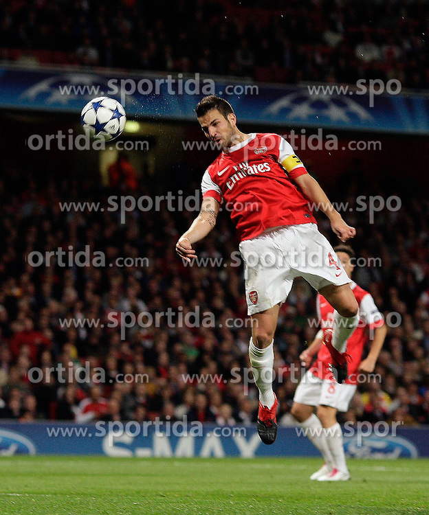 15.09.2010, Emirates Stadium, London, ENG, UEFA CL, Arsenal fc vs Sporting Braga, im Bild Arsenal's Cesc Fabregas (captain) makes 4-0 with this header and celebrates with co-scorers Arsenal's Andrei Arshavin and Arsenal's Marouane Chamakh    during Arsenal fc vs Sporting Braga for the UCL  Group  H at the Emirates Stadium in London. EXPA Pictures © 2010, PhotoCredit: EXPA/ IPS/ Marcello Pozzetti +++++ ATTENTION - OUT OF ENGLAND/UK +++++ / SPORTIDA PHOTO AGENCY