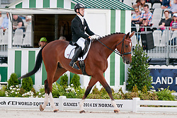 Rihards Snikus riding Chardonnay in the Grade 1a Para-Dressage at the 2014 World Equestrian Games, Caen, Normandy, France..
