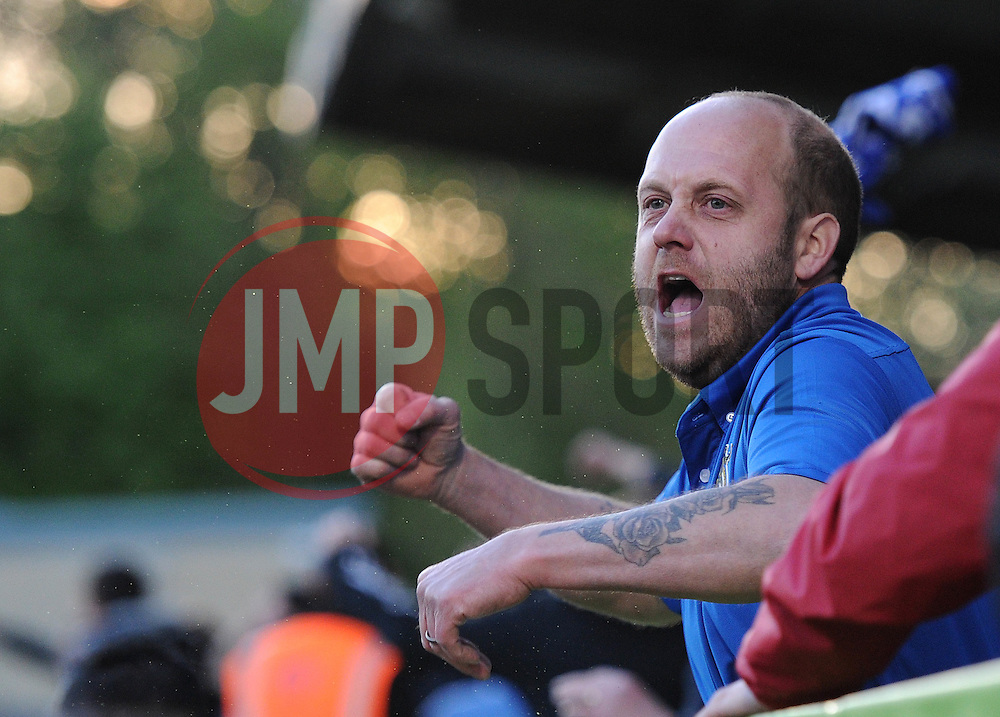 A Bristol Rovers fan celebrates as Bristol Rovers' Matt Taylor scores - Photo mandatory by-line: Dougie Allward/JMP - Mobile: 07966 386802 - 29/04/2015 - SPORT - Football - Nailsworth - The New Lawn - Forest Green Rovers v Bristol Rovers - Vanarama Football Conference