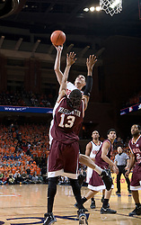 Virginia Cavaliers forward Jason Cain (33) shoots over Virginia Tech Hokies forward Deron Washington (13).  The Virginia Cavaliers Men's Basketball Team defeated the Virginia Tech Hokies 69-56 at the John Paul Jones Arena in Charlottesville, VA on March 1, 2007.
