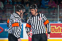 KELOWNA, CANADA - DECEMBER 3: Referees Jeff Ingram and Reid Anderson speak at centre ice at the start of the game between the Kelowna Rockets and the Brandon Wheat Kings on December 3, 2016 at Prospera Place in Kelowna, British Columbia, Canada.  (Photo by Marissa Baecker/Shoot the Breeze)  *** Local Caption ***