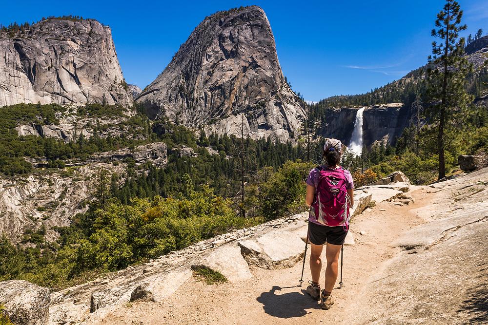 Hiker on the John Muir Trail below Nevada Fall, Yosemite National Park, California USA
