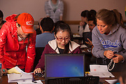 Student volunteers Lindsey Marginian (Left) and Sarah Weisenberger (Right) assist international student Xiumin Jin of China complete her tax forms at a volunteer income tax assistance program offered by the College of Business at Ohio University.