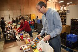 United States, Washington, Bellevue, man volunteering at food bank