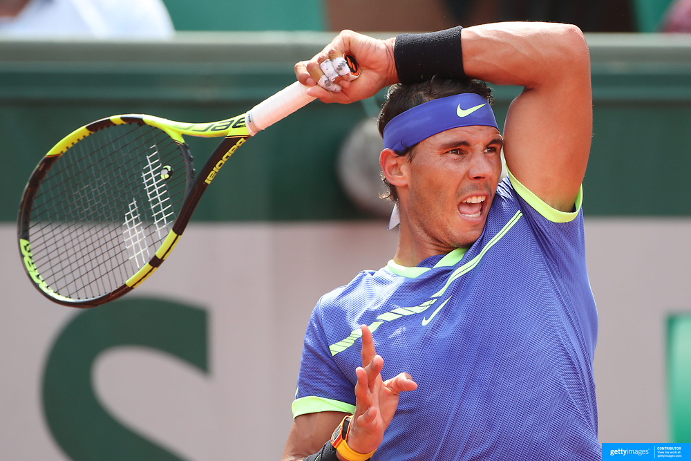2017 French Open Tennis Tournament - Day Two.  Rafael Nadal of Spain in action against Benoit Paire of France on Court Suzanne-Lenglen during the Men's Singles Round one match at the 2017 French Open Tennis Tournament at Roland Garros on May 29th, 2017 in Paris, France.  (Photo by Tim Clayton/Corbis via Getty Images)
