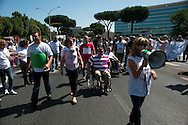 Roma 20 Giugno  2011.Sede Regione Lazio..Manifestazione di utenti ,lavoratori e medici contro la chiusura dell'ospedale Santa Lucia, struttura per la riabilitazione. I manifestanti hanno occupato   via Cristoforo Colombo.Rome, June 20, 2011..Lazio Region.protest of members, workers and doctors against the closure of the hospital Saint Lucia, facility rehabilitation.