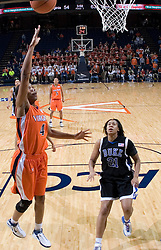 Virginia Cavaliers Center Siedah Williams (4) shoots as Duke Blue Devils Forward Joy Cheek (21) watches in the lane.  The University of Virginia Cavaliers lost to the #1 ranked Duke University Blue Devils 76-61 at the John Paul Jones Arena in Charlottesville, VA on February 2, 2007.