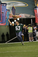 GREEN BAY, WI - SEPTEMBER 08: Chris Gizzi #57 of the Green Bay Packers runs on the field holding the American Flag before the game against the New Orleans Saints  during the NFL opening season game at Lambeau Field on September 8, 2011 in Green Bay, Wisconsin. The Packers defeated the Saints 42-34. (Photo by Tom Hauck/Getty Images) *** Local Caption ***Chris Gizzi