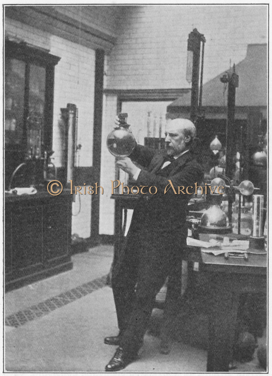 James Dewar (1842-1923) in his laboratory holding one of his vacuum flasks. Scottish chemist and physicist. Vacuum flask: cordite. From a picture published London 1910
