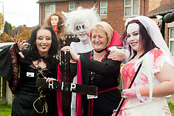 Guinness Northern Counties Housing Associations Godley Street  Scheme Hold a Halloween Street Party.left to right residents Claire Williams, Darren Broad Hurst, Guinness Northern Counties Housing Officer Shirley Adshead and Becki Mallinder..30 October 2010 .Images © Paul David Drabble