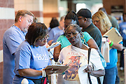 Volunteers registers patients during a free medical mission held by the SC Dental Association on August 23, 2013 in North Charleston, South Carolina. More than 1,000 people showed up to receive free dental and medical care.