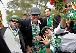 12 March 2016. New Orleans, Louisiana.<br /> The Irish Channel St Patrick's Day parade makes its way along Magazine Street.<br /> Photo&copy;; Charlie Varley/varleypix.com
