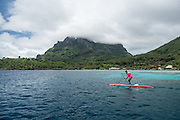 SUP racers on the third day of the Ironmana raced around Bora Bora.
