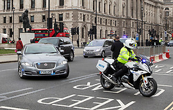 © Licensed to London News Pictures. 18/03/2020. London, UK. The Prime Minister Boris Johnson's convoy passes through near empty streets as he heads to Parliament for Question Time. The government has announced £350 billion in loans will be available for UK businesses as the virus takes hold.  Photo credit: Peter Macdiarmid/LNP