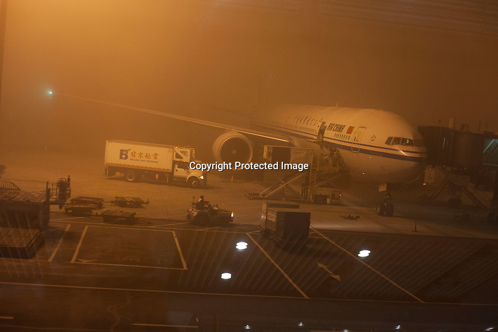 """BEIJING, DEC.23,2015 : a view of a plane that's """"stranded"""" at Beijing airport due to """"harzadous"""" smog during Beijing's 2.nd """"red alert"""" in one month."""