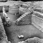Barbar Temple II, photograph, containing a sacrificial courtyard, altars, shrines and an underground shrine built around a fresh water spring, in the Bahrain National Museum, designed by Krohn and Hartvig Rasmussen, inaugurated December 1988 by Amir Shaikh Isa Bin Salman Al-Khalifa, in Manama, Bahrain. This large temple was discovered near the village of Barbar and the site consists of 3 successive temples, with the 2 oldest temples terraced with a central platform above an outer oval platform, in Sumerian style. The Bahrain National Museum houses cultural and archaeological collections covering 6000 years of history, with rooms entitled Burial Mounds, Dilmun, Tylos and Islam, Customs and Traditions, Traditional Trades and Crafts, and Documents and Manuscripts. Picture by Manuel Cohen