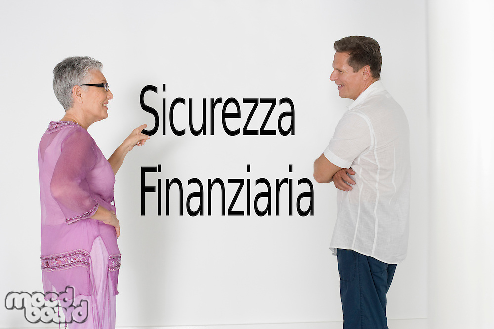 Couple discussing financial security against white wall with Italian text