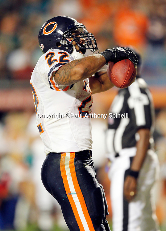Chicago Bears running back Matt Forte (22) pumps his arms and celebrates after running for a third quarter touchdown that gives the Bears a 16-0 lead during the NFL week 11 football game against the Miami Dolphins on Thursday, November 18, 2010 in Miami Gardens, Florida. The Bears won the game 16-0. (©Paul Anthony Spinelli)