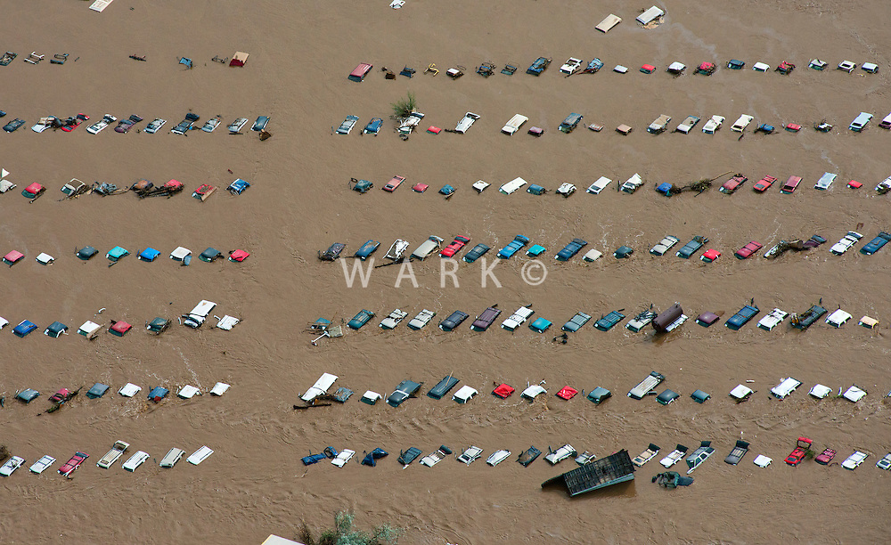 Flooding along South Platte River in Weld County, Colorado.  Car salvage yard in Greeley.
