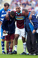 Photo: Daniel Hambury.<br /> Reading v Burnley. Coca Cola Championship.<br /> 29/08/2005.<br /> Burnley's Wayne Thomas is forced to leave the field after what seems a serious injury.