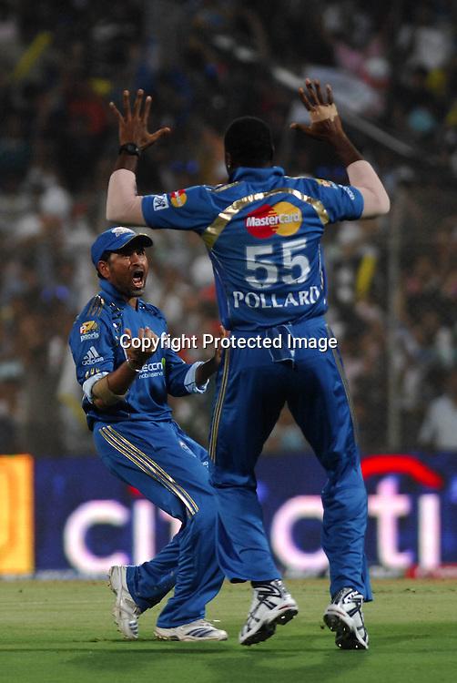 Mumbai Indians Captain Sachin Tendulkar Celebrate WIth Kieron Pollard After Taken Adam Gilchrist Catch During The Deccan Chargers vs Mumbai Indians, 25th Twenty20 match Indian Premier League- 2009/10 season Played at Dr DY Patil Sports Academy, Mumbai 28 March 2010 - day/night (20-over match)