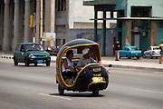 A coco taxi drives along the malecon in Havana, Cuba on Saturday June 28, 2008.