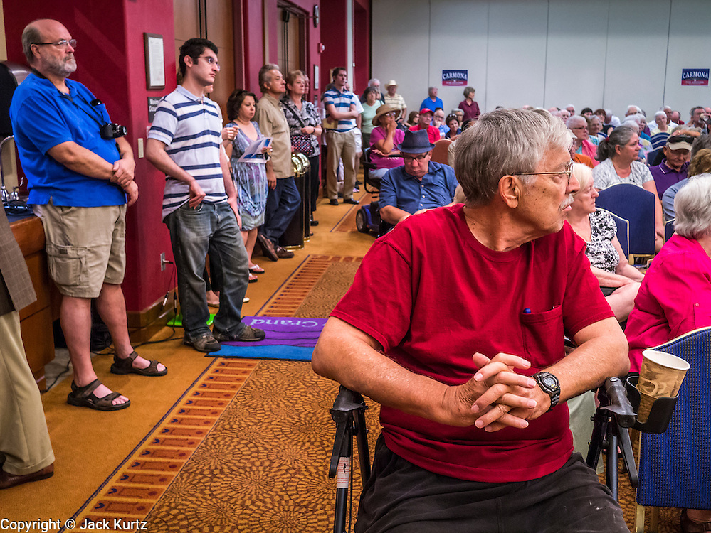 08 SEPTEMBER 2012 - SURPRISE, AZ:   Voters listen to Dr. Richard Carmona during a town hall meeting with Dr. Richard Carmona in Surprise, AZ. Carmona, a Democrat, is from Tucson, AZ. He is a former US Surgeon General, former Green Beret, and former SWAT Police officer, is running for the US Senate being vacated by Republican Sen. Jon Kyl. His opponent in the November election is Rep. Jeff Flake, a long serving Congressman from Mesa, a suburb of Phoenix. PHOTO BY JACK KURTZ