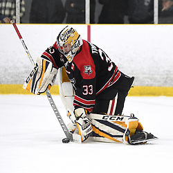 TORONTO, ON  - APR 10,  2018: Ontario Junior Hockey League, South West Conference Championship Series. Game seven of the best of seven series between Georgetown Raiders and the Toronto Patriots. Troy Timpano #33 of the Georgetown Raiders blocks the shot during the first period.<br /> (Photo by Andy Corneau / OJHL Images)