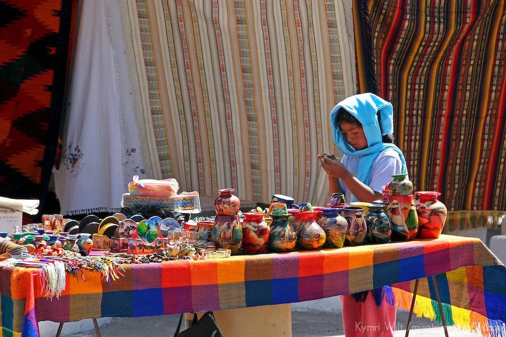 South America, Ecuador, Otavalo.  Smiles and textiles of the Otavalo Market in the Andes of Ecuador.