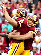 Washington Redskins kicker Graham Gano celebrates with holder Sav Rocca after kicking a 34-yard game winning field goal against the Arizona Cardinals during the fourth quarter at FedEx Field in Washington on September 18, 2011. The Redskins defeated the Cardinals 22-21. UPI/Kevin Dietsch