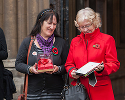 © Licensed to London News Pictures. 23/10/2015. Bristol, UK.  23/10/2015. Bristol, UK. Relatives of Bristol Poppy seller Olive Cooke at an event outside Bristol Cathedral, organised by the Royal British Legion, receive a ceramic poppy in memory of Olive from the Blood Swept Lands and Seas of Red exhibition.  L-R:  Kathryn King (daughter), Carol Balson (step-daughter).  Photo credit : Simon Chapman/LNP