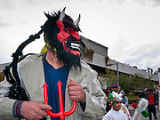 "03 DECEMBER 2011 - PHOENIX, AZ:   A demon, who threatens the Virgin and other innocents, in a procession to honor the Virgin of Guadalupe in Phoenix Saturday. Matachine dancers protect the Virgin from the Demon. The Phoenix diocese of the Roman Catholic Church held its Sixth Annual Honor Your Mother Day Saturday to honor the Virgin of Guadalupe. According to Mexican Catholic tradition, on December 9, 1531 Juan Diego, an indigenous peasant, had a vision of a young woman while he was on a hill in the Tepeyac desert, near Mexico City. The woman told him to build a church exactly on the spot where they were standing. He told the local bishop, who asked for some proof. He went back and had the vision again. He told the lady that the bishop wanted proof, and she said ""Bring the roses behind you."" Turning to look, he found a rose bush growing behind him. He cut the roses, placed them in his poncho and returned to the bishop, saying he had brought proof. When he opened his poncho, instead of roses, there was an image of the young lady in the vision. The Virgin is now honored on Dec 12 in Catholic churches throughout Latin America and in Hispanic communitied in the US.   PHOTO BY JACK KURTZ"