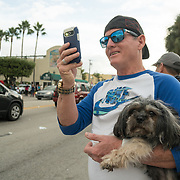 MIAMI, FL - NOVEMBER 26: Miami resident Hugo Rodriguez and his dog Ringo following the news of the death of former Cuban President Fidel Castro Ruz. Many, mostly Cubans, gathered outside popular Miami restaurant Versailles to wave flags and celebrate the news, on NOVEMBER 26, 2016 in Miami, Florida. (Photo by Angel Valentin/Getty Images)